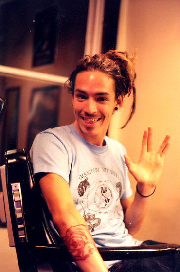 Brandon Boyd's doing the Vulcan salute. Live long and prosper. :)